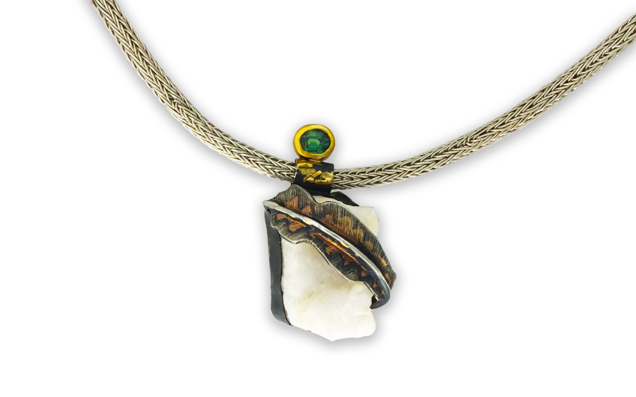 The Flicker Feather - Raw quartz set in black oxidized silver with green sapphire set in 22kt gold.  Hand woven five row chain in .999 silver.