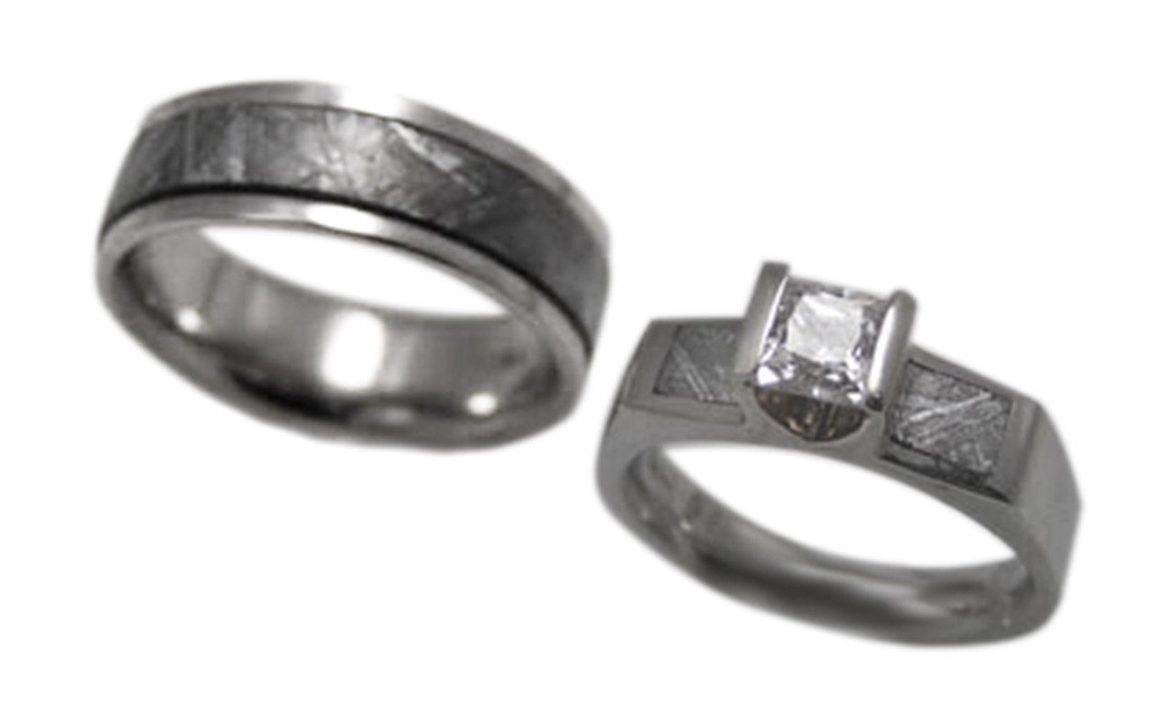 Wedding set gibbon meteorite inlay in 18 kt white gold with a .75 ct princess cut diamond.