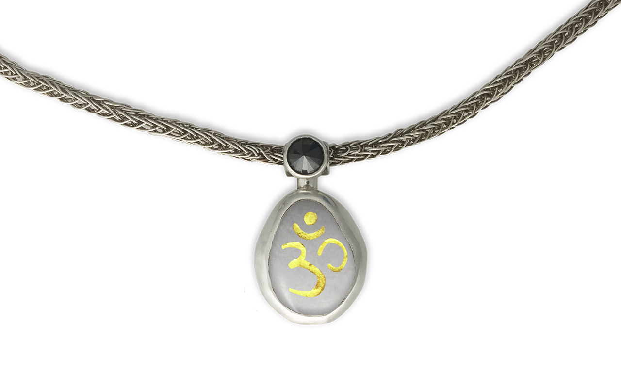 Rebirth of a Sacred Temple - Om etched in 24kt gold in marble 0.50ct black diamond.  Hand woven chain sterling silver.