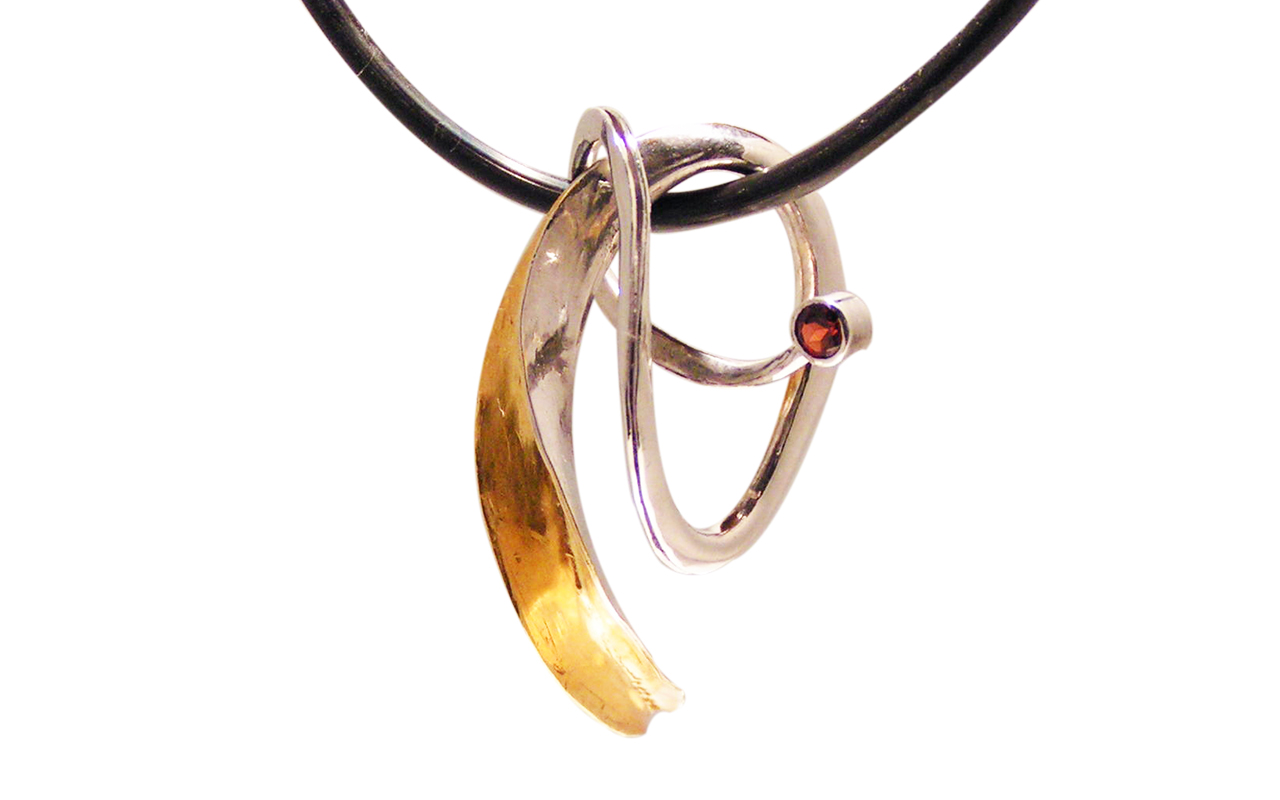 Pendant made of 24kt and sterling bi metal.