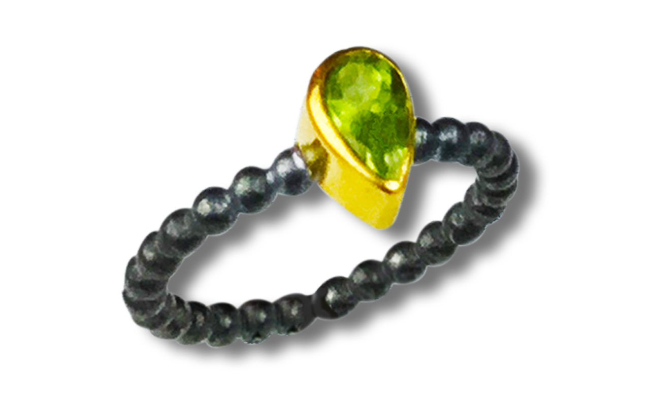 Prosperity Peridot - set in 22kt gold and heavy black oxidized silver.