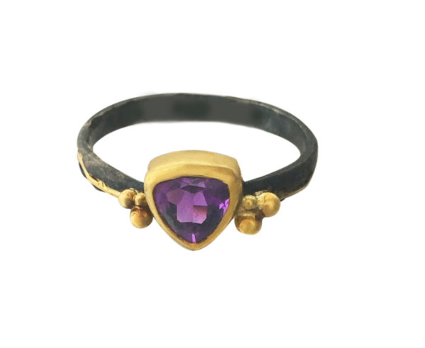 Trillion shape Amethyst set in 22kt gold and heavy black oxidized silver.
