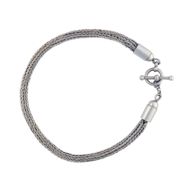 This is a double weave, five row, 4mm wide Viking knit bracelet. The material of the chain is pure (0.999) fine silver wire. The toggle clasp is sterling silver.